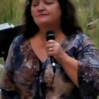 CINDY SINGING 2016 PINE VALLEY AMPITHEATER cropped.jpg